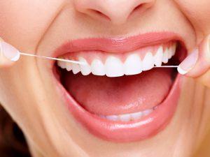 Правила самостоятельного использования зубной нити